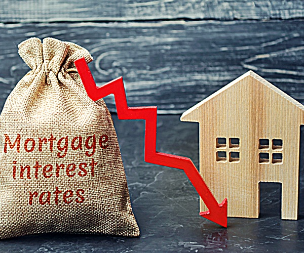 Bag with the money and the word Mortgage interest rates and arrow to down and house. Low interest in mortgages. Reducing interest payments for mortgages. The fall in housing rates on credit. Low housing demand